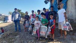 Kuşadası Kimsesizler Derneği 100 çocuğu giydirdi