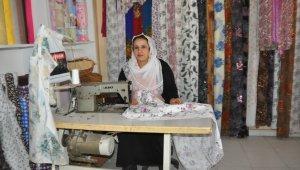 Mikro kredi ile kendi işini kuran 5 çocuk annesi, eşini de yanına yardımcı olarak aldı